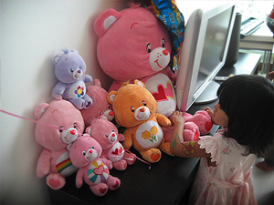 Cleo looking at Care Bears